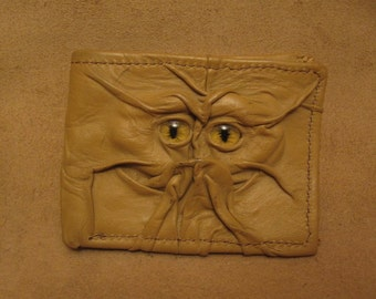 Grichels leather bi-fold wallet - sandy tan with yellow slit pupil eyes