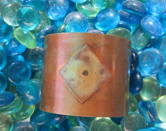 Copper and bronze cuff bracelet creates a riveting look