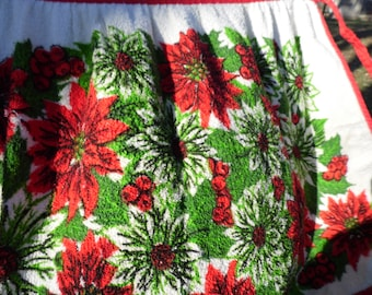 Apron vintage Christmas apron tie at waist with red green and white poinsettia flowers outlined in black with green leaves red berries