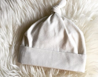 Infant Cotton Knit  Top Knot  Beanie Hat in creamy white