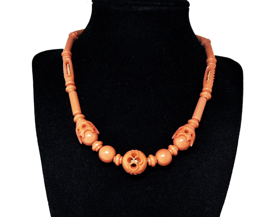 early century plastic bead necklace choker necklace carved