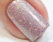 "Nail polish - ""It's Sunday Somewhere""""  A light pink with gold shimmer and micro glitters"