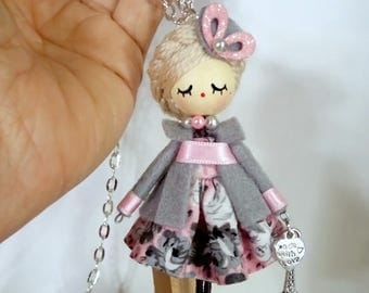 Brooch doll and necklace.