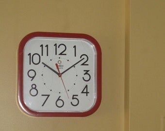 "Red Timex 9 "" square Clock"