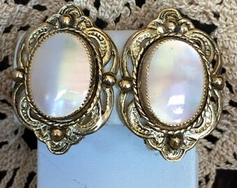 Pretty Mother of Pearl set in Gold tone setting clip earrings