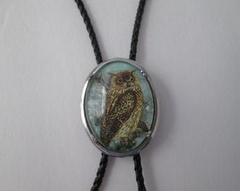 Owl bolo tie- glass cabochon on black leather cord- 30 x 40 mm
