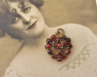 Bohemian paste garnet heart charm or pendant in aged brass