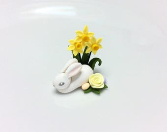 Miniature Easter bunny rabbit decoration with daffodils for 1:12 scale dollhouse handmade from polymer clay