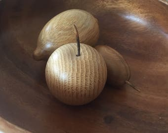 A vintage set of three wooden fruits.