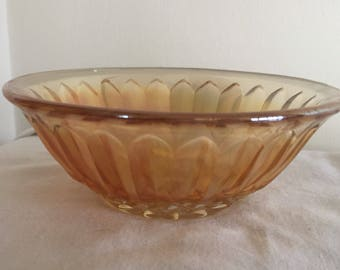 A small vintage carnival glass bowl.