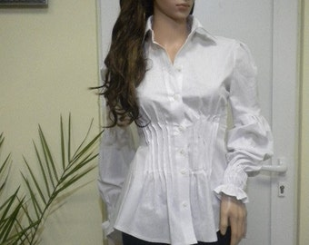 Elegant lady in white shirt made of cotton textiles.