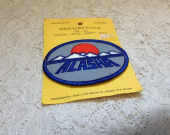 Alaska New Old Stock Patch Applique Crafts Sewing Mixed Media Oval blue Mountains Sun Embrodered