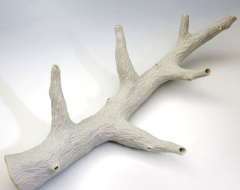 Porcelain carved white branch with 6 side branches, unglazed, faux bois