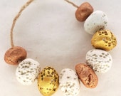 The idea of deserving -- a set of 9 gold, copper and white ceramic beads