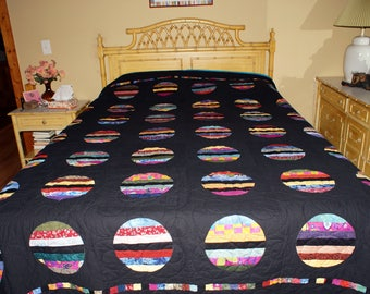 One-of-a-kind handmade Circles of Color Queen Size Quilt made by Barb Lynn and quilted by Vicki at Quilted by Vicki.