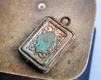 Antique  brass charm, pendant, lock pendant, dark patina