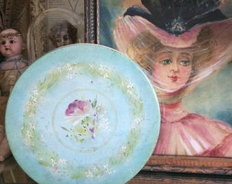 This Round Vintage Faded Floral Tin Is Easy On The Eyes