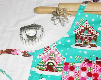 Gingerbread House Child Apron - aqua with candy pocket