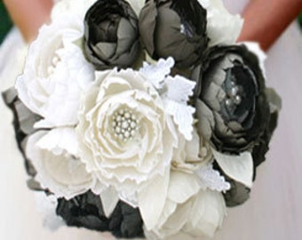 Bride bouquet . Pure silk dupioni and velvet flowers in grays and soft white . Lace, fresh water pearls, brooches