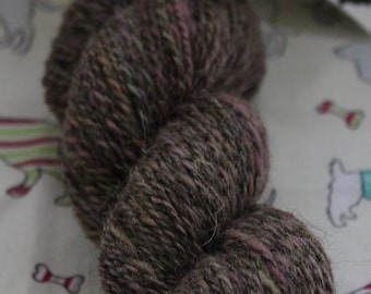 100% wool, hand spun. DK weight. Grey and muted lilac. 105gms