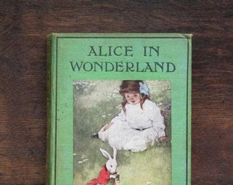 Alice in Wonderland 1930s children's book by Lewis Carroll. Illustrated by Bessie Pease Gutmann. Alices' Adventures in Wonderland