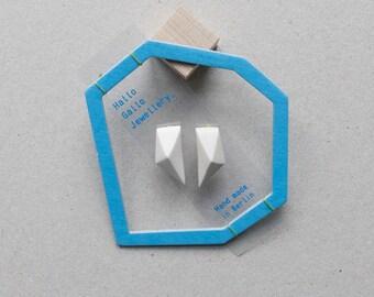 White minimal geometric triangle stud silver earrings.