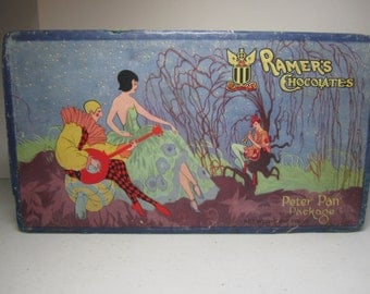 Gorgeous art deco 1920's Ramer's Chocolates Peter Pan Package colorful fantasy forest with harlequin ,peter pan and pretty deco lady