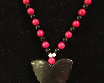 Onyx butterfly pendant and red coral necklace.