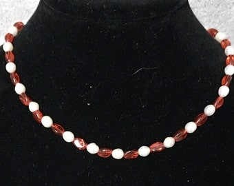 Red and white elegance in a choker.