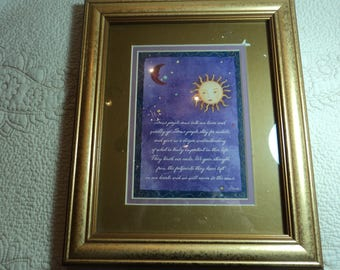 Print in gold wooden frame