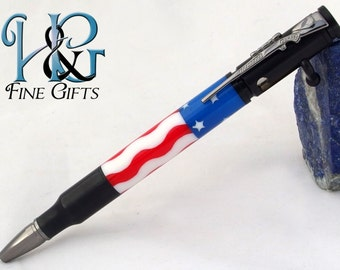 Bolt Action Bullet Pen in American flag with rifle clip, handcrafted pen with waving stripes and white stars in blue field in jet black