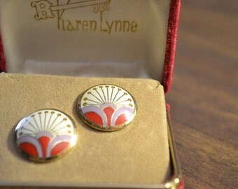 sorry this item is not fully listed as yet.  Earrings being listed. Great condition