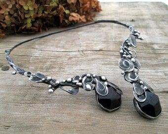 metal  pendant with Garnet