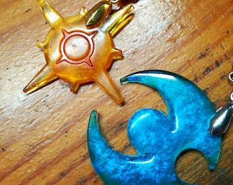 Pokemon sun and moon symbol pendants