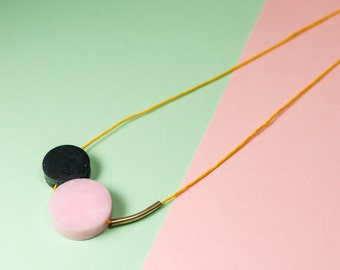 Pulling Shapes statement necklace // 'rose quartz' pink & 'graphite' black disc necklace on yellow cotton cord
