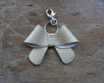 gold leather bow shaped keychain