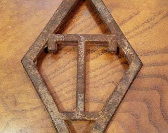 Antique T. Eaton Company Cast Iron Trivet