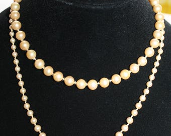 Lot of 2 vintage faux pearl necklaces.
