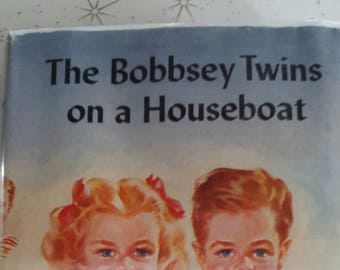 Vintage book 1943 /the bobbsey twins on a houseboat/ hardcover /Laura Lee hope/ no. 6/ Grosset and Dunlap/