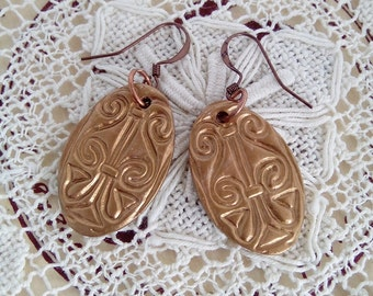 Gold dangly polymer clay earrings with egyptian pattern