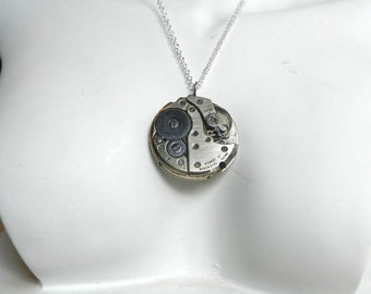 Steampunk Pendant from Jewelled Swiss Watch movement.