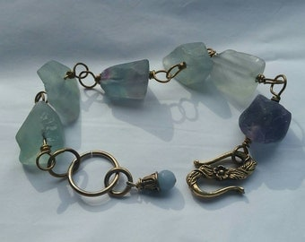 Rough tumbled flourite nugget and brass bracelet