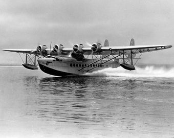 A Pan American Airways Sikorsky S-42 flying boat taking off, Clipper Ship, 1940s
