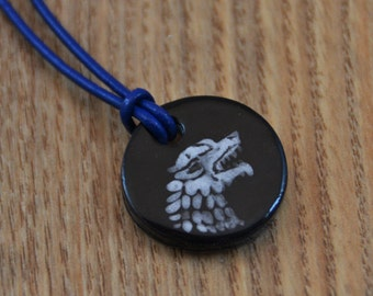 Stark Crest Ceramic Medaillon on a Leather Necklace