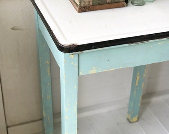 A lovely French vintage enamel topped kitchen table