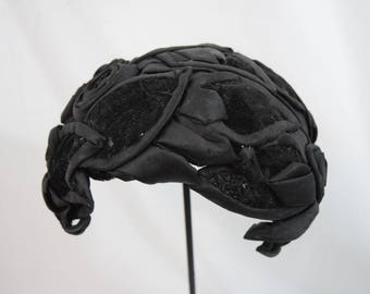 Vintage 1950s 1960s crown cap hat black satin and velvet petals and rosettes