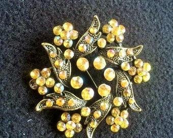 Starburst rhinestone decorated vintage brooch