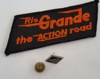 Vintage railroad items, embroidered patch and pin Rio Grande The Action Road, Reading Lines