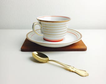 "Hand painted vintage Arabia Finland  coffee cup and saucer named ""Raitakulta"" by Greta Lisa Jäderholm-Snellman, 1960s, Made in Finland"
