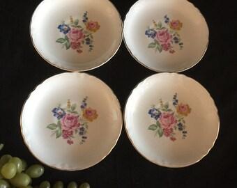 H054  set of 4 porcelain bowls w/flowers